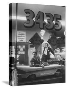 Men Standing in the Window of a Car Dealership by Francis Miller