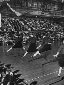 Peppy High School Girl Cheerleaders During their Cheers at the Basketball Game by Francis Miller