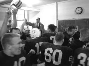 Players and their Coach, Murray Warmath, Minnesota-Iowa Game, Minneapolis, November 1960 by Francis Miller