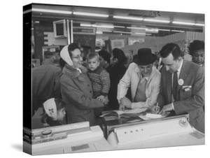 Shoppers Looking at Appliances in Polk's Department Store by Francis Miller