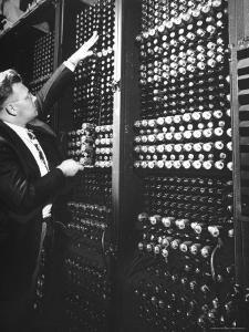 Technician Manipulating 1 of Hundreds of Dials on Panel of IBM's Room Size Eniac Computer by Francis Miller