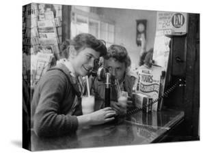Teenage Girls Drinking Milkshakes at a Local Restaurant by Francis Miller