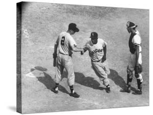White Sox Player Nellie Fox at Home Plate, Shaking Hands with Minnie Minoso During Game by Francis Miller