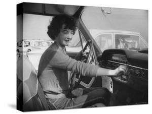 Woman Checks Out the New Ford, During the Huge Auto Promotion Scheme to Show New Fords by Francis Miller