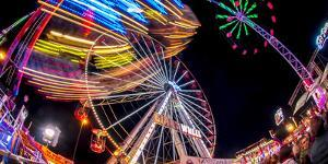 Ferris Wheel and various other funfair rides at night at Nottingham's Goose Fair, Nottingham, Notti by Frank Fell