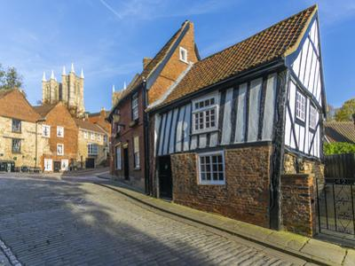 Lincoln Cathedral and timbered architecture viewed from the cobbled Steep Hill, Lincoln, Lincolnshi by Frank Fell
