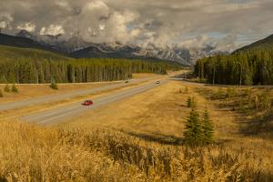 Traffic on Trans Canada Highway 1, Canadian Rockies, Banff National Park, UNESCO World Heritage Sit by Frank Fell