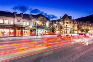 Trail lights and shops on Banff Avenue at dusk, Banff, Banff National Park, Alberta, Canada, North  by Frank Fell