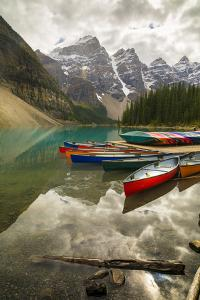 Tranquil setting of rowing boats on Moraine Lake, Banff National Park, UNESCO World Heritage Site,  by Frank Fell