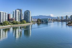 View of False Creek from Cambie Street Bridge and Vancouver skyline, Vancouver, British Columbia, C by Frank Fell