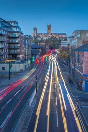 View of Lincoln Cathedral and traffic on Broadgate at dusk, Lincoln, Lincolnshire, England, United  by Frank Fell