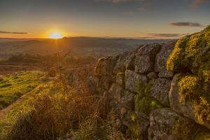 View of sunset from dry stone wall on Baslow Edge, Baslow, Peak District National Park, Derbyshire, by Frank Fell