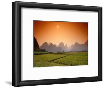 Rice fields an chalk mountains at twilight, Yangshou, Guangxi Province, China