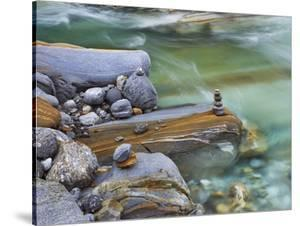 Small stone cairn on striated boulder in the Verzasca River by Frank Krahmer