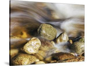 Water rushing past river stones by Frank Krahmer
