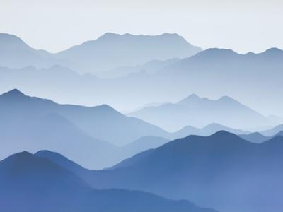 Yellow Mountains silhouetted in haze in China by Frank Krahmer