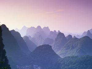 Mountains in Guangxi Province, China by Frank Lukasseck