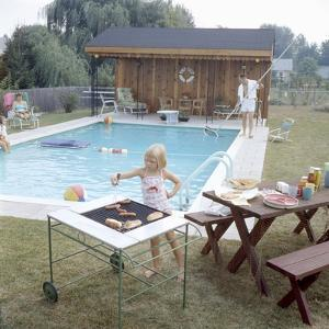 1959: Family Cookout and Enjoying the Backyard Swimming Pool, Trenton, New Jersey by Frank Scherschel
