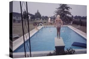 1959: Susan in Diving Stance During a Family Cookout, Trenton, New Jersey by Frank Scherschel