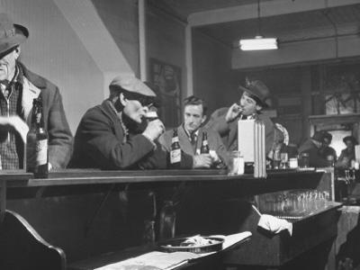 Author William T. Bushman Sitting at a Bar