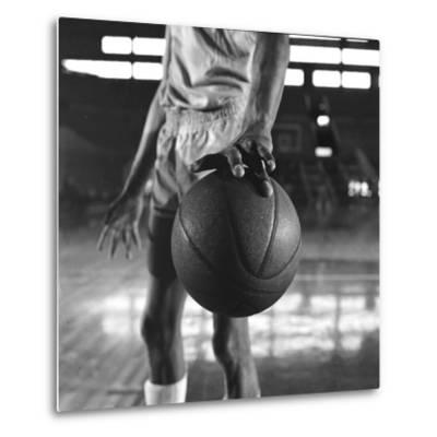 Basketball Held by Player Wilt Chamberlain, 1956