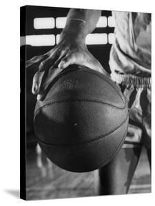 Basketball Player Wilt Chamberlain Holding a Basketball by Frank Scherschel