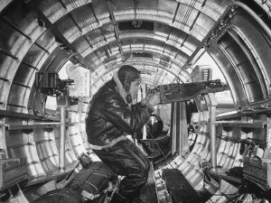 Crewman Poking His 50 Cal. Machine Gun Out of Side Window of B-17E Flying Fortress During WWII by Frank Scherschel