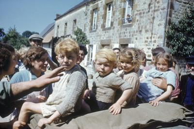 French Children in the Town of Avranches Sitting on Us Military Jeep, Normandy, France, 1944