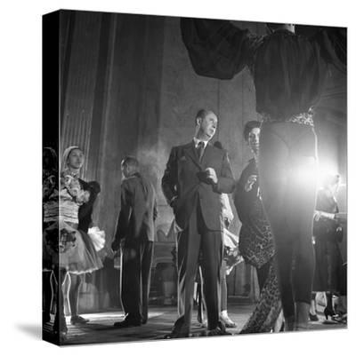 French Designer Christian Dior Adjusting a Leopard-Print Fabric on a Dancer, Paris, November 1947