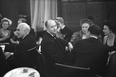 French Designer Christian Dior Drinking with Unidentified Others at a Bar, Paris, November 1947