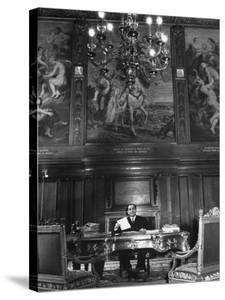 French Premier Pierre Mendes France, Smiling Slightly and Reserved, Working in Ornate Office by Frank Scherschel