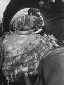 Miss Dominican Republic Signing Autographs During a Parade by Frank Scherschel