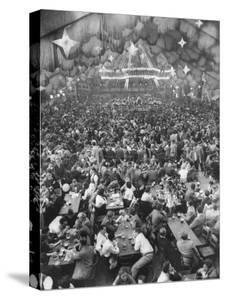 Oktoberfest, Drinking Beer, Singing, Dancing, Tents Setup for Drinking, Band under Canvas Clouds by Frank Scherschel