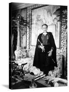 Poet and Filmmaker Jean Cocteau Dressed in Uniform of Academie Francaise, Holding Sword He Designed by Frank Scherschel