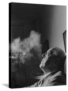 Portrait of Architect Mies Van Der Rohe Exhaling Smoke by Frank Scherschel