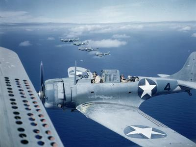 Squadron of Us Douglas Sbd-3 Dauntless in Flight as Patrolling Coral Reefs Off Midway Island, 1942