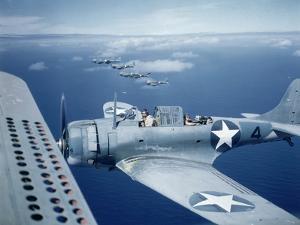 Squadron of Us Douglas Sbd-3 Dauntless in Flight as Patrolling Coral Reefs Off Midway Island, 1942 by Frank Scherschel