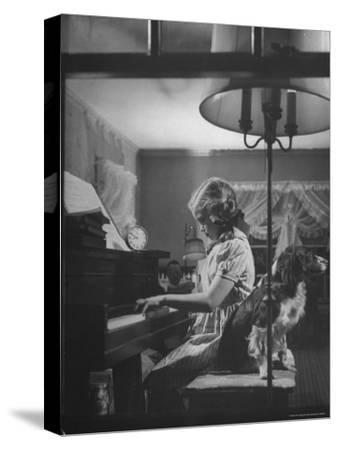 "Suzy Creech, Typical Girl Known as a ""Pigtailer"" at Home Playing the Piano"