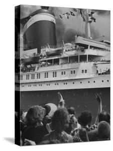 The Ship United States, under Flags, Going on First Trip, with Passengers Waving to Those on Shore by Frank Scherschel