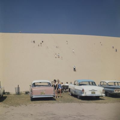 Tourists in Bathing Suits by Parked Cars and Climbing the Sleeping Bear Sand Dunes, Michigan, 1961