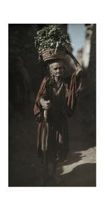 An Elderly Woman Carries Food in a Basket Through Town by Franklin Price Knott