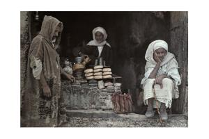 Tunisian Men Sit Outside a Bread and Olive Oil Shop by Franklin Price Knott