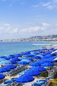 Blue parasols on the beach, Promenade des Anglais, Nice, Alpes Maritimes, Cote d'Azur, Provence, Fr by Fraser Hall