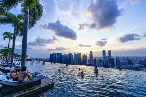 Infinity Pool on Roof of Marina Bay Sands Hotel with Spectacular Views over Singapore Skyline by Fraser Hall
