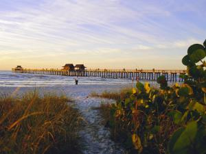 Naples, Florida, USA. Sunset at the Beach and Pier by Fraser Hall