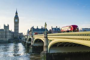 Red bus crossing Westminster Bridge towards Big Ben and the Houses of Parliament, London, England, by Fraser Hall
