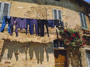 Volterra, Tuscany, Italy. Washing Hanging on a Line by Fraser Hall