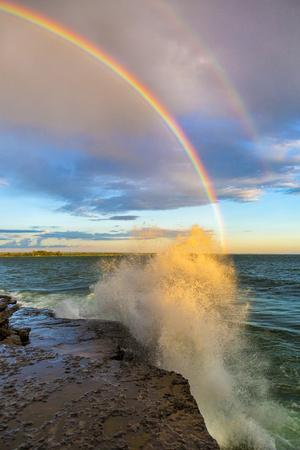 USA, New York, Lake Ontario, Clark's Point. Double rainbow over lake.