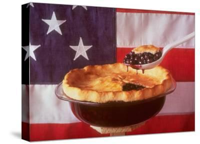 Deep Dish Blueberry Pie, with a scoop in front of the American Flag