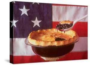 Deep Dish Blueberry Pie, with a scoop in front of the American Flag by Fred Lyon